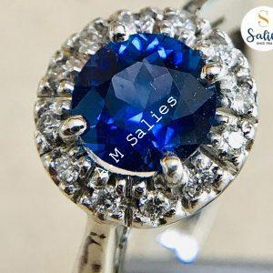 Blue Sapphire and Diamond Halo Ring in white gold