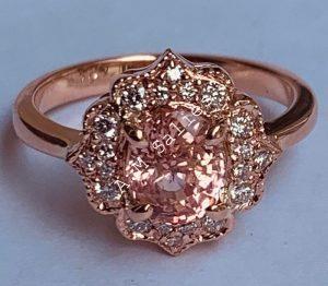 14 karat Rose Gold ladies ring with diamonds and Natural Padperajah Sapphire