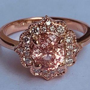 14 karat Rose Gold ladies ring with diamonds and Natural Padperajah Sapphire