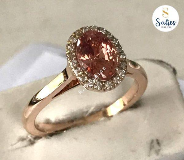 Halo Ring with Padperajah Sapphire in Rose Gold.