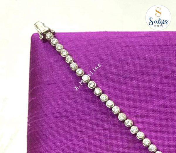 Tennis Bracelet set in 14 k white Gold Studded with Diamonds.
