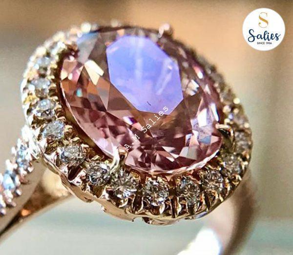 14 karat Rose Gold ring with Padperajah Sapphire and 38 diamonds