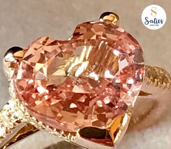 14 karat Rose Gold ring with Padperajah Sapphire and 12 diamonds