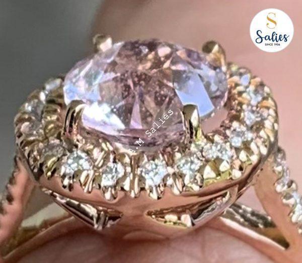 14 karat Rose Gold Ring set with Diamonds and Peach Sapphire