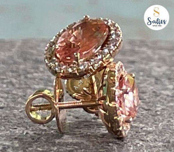 14 karat Rose Gold earrings with diamonds and Padperajah sapphires