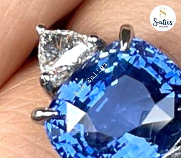 Platinum ring set with a Natural Ceylon blue sapphire and trillion cut diamonds